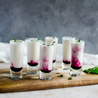 These creamy coconut lime mojito shooters with a hit of blueberry are your new tropical getaway.
