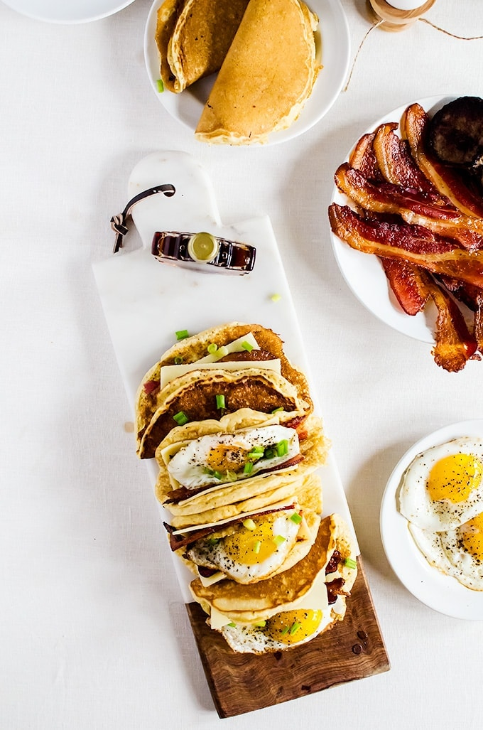 American breakfast tacos. Light and fluffy pancakes act as a vehicle for thick slices of bacon, melted cheese, and fried eggs. Smother the whole thing in maple syrup and you have the best breakfast ever!
