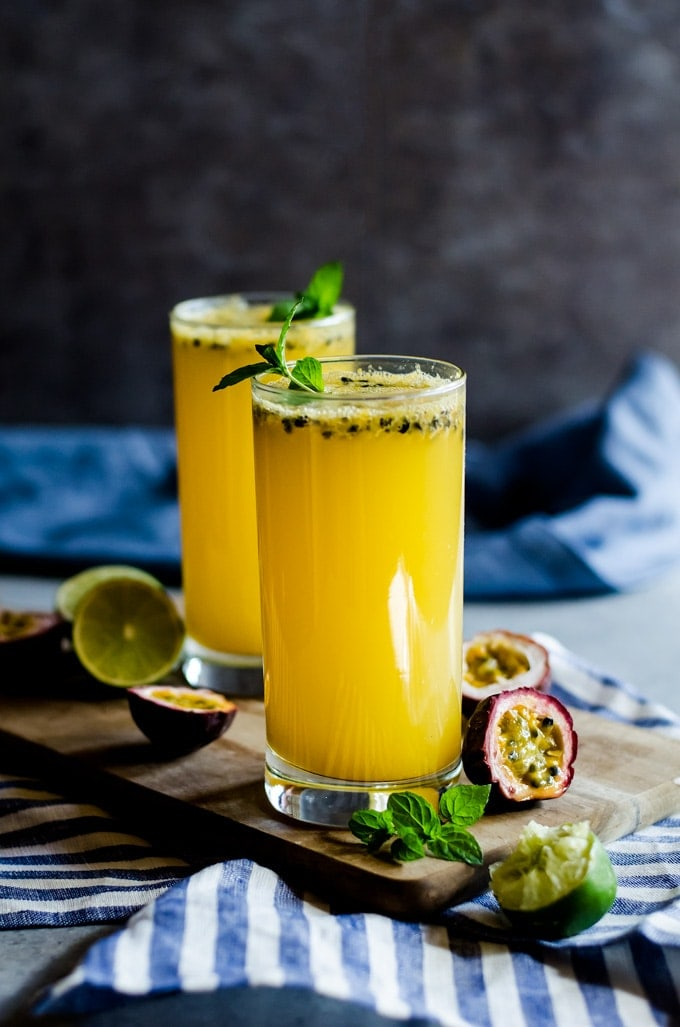 passion fruit mojito in glass with mint on cutting board