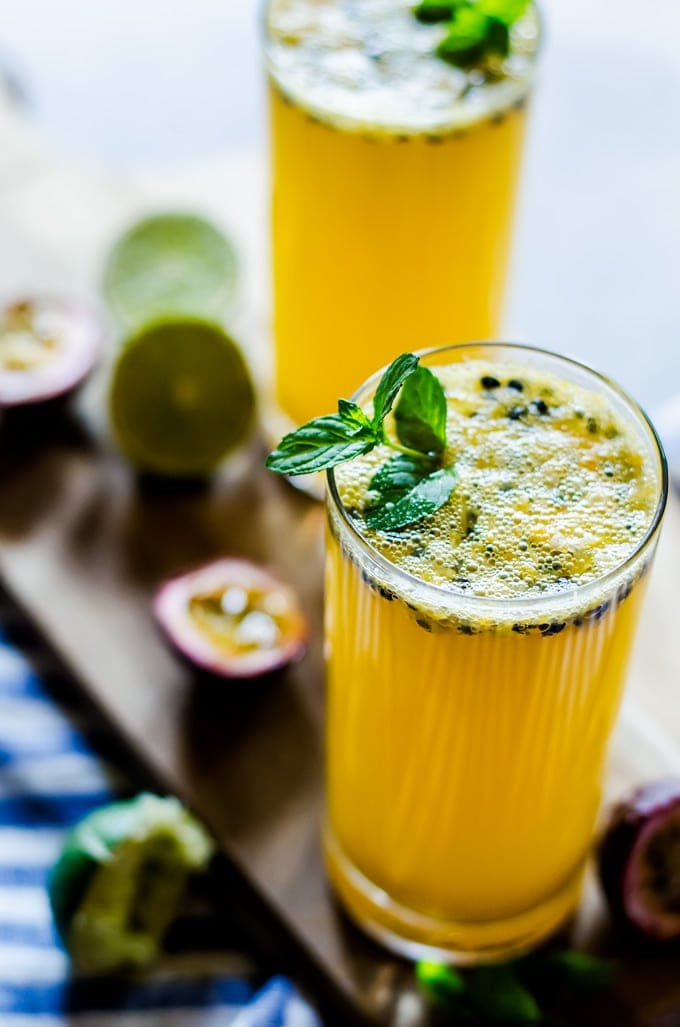 passion fruit mojito in glass on cutting board