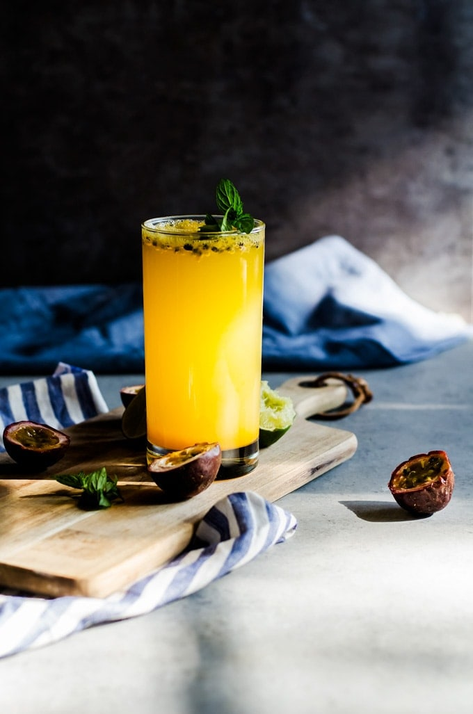 passion fruit mojito with glass on cutting board
