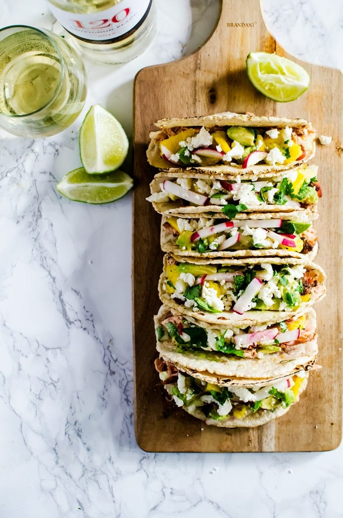 Get your summer on with these grilled salmon tacos with mango avocado salsa