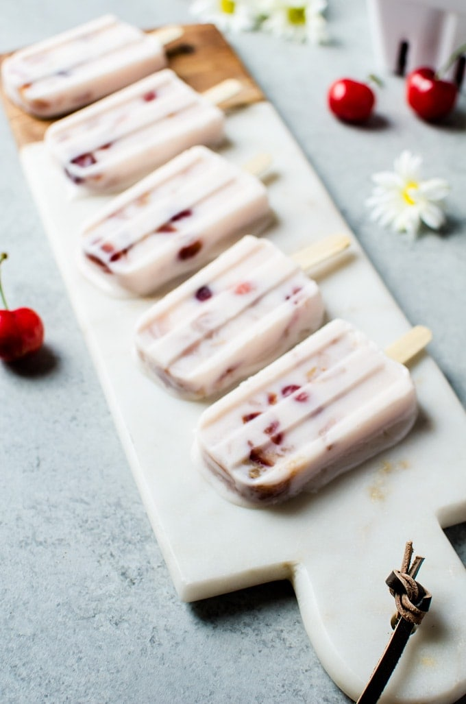 Try to not eat the entire batch of these lychee cherry frozen yogurt popsicles.