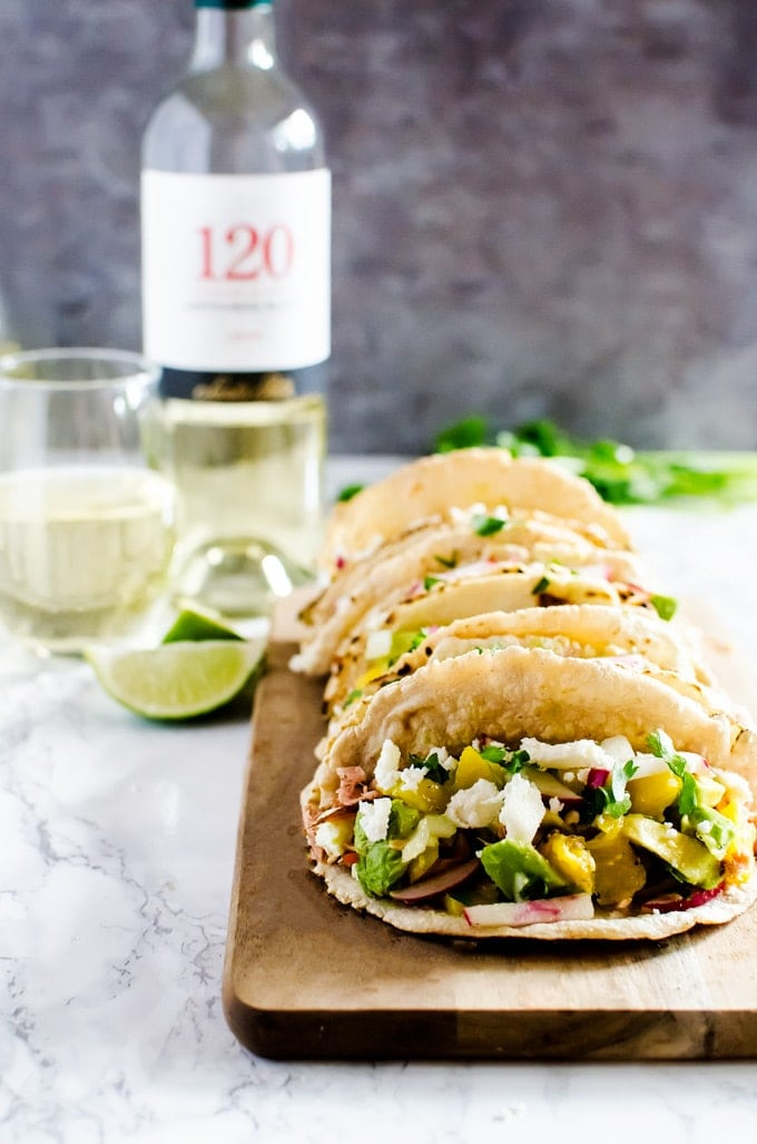 Salmon tacos with mango avocado salsa recipe. Perfect for your next summer BQ