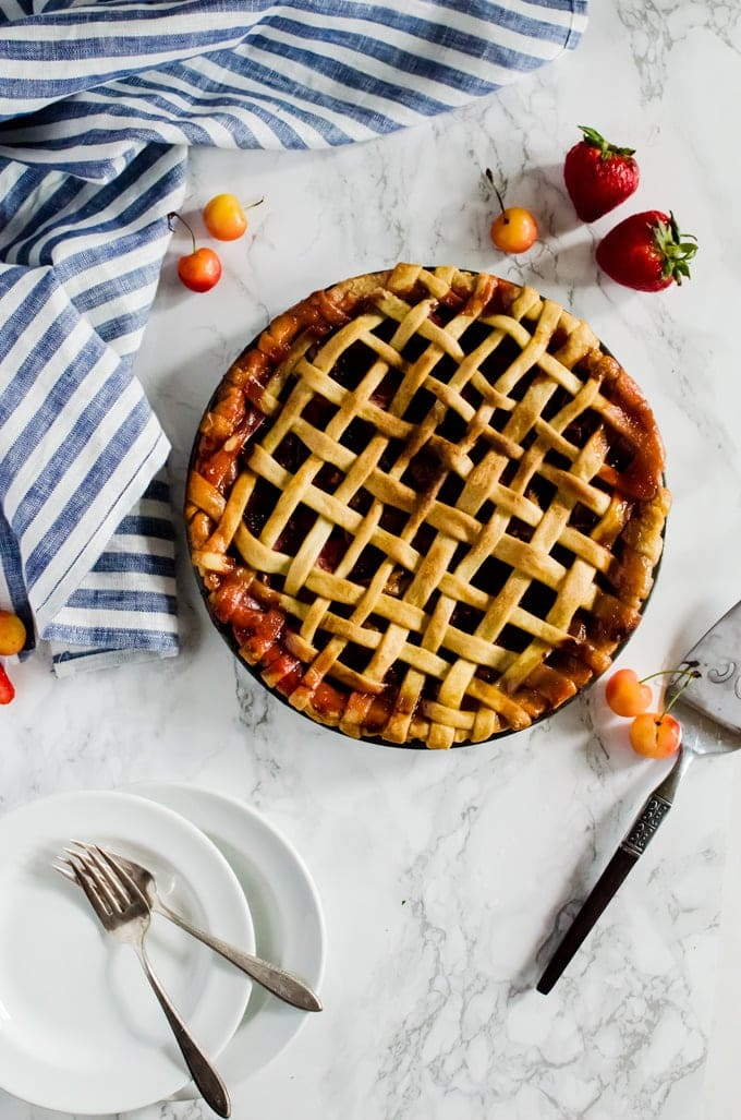 This strawberry cherry pie is a crowd pleasing dessert that is perfect on its own or with a nice scoop of ice cream