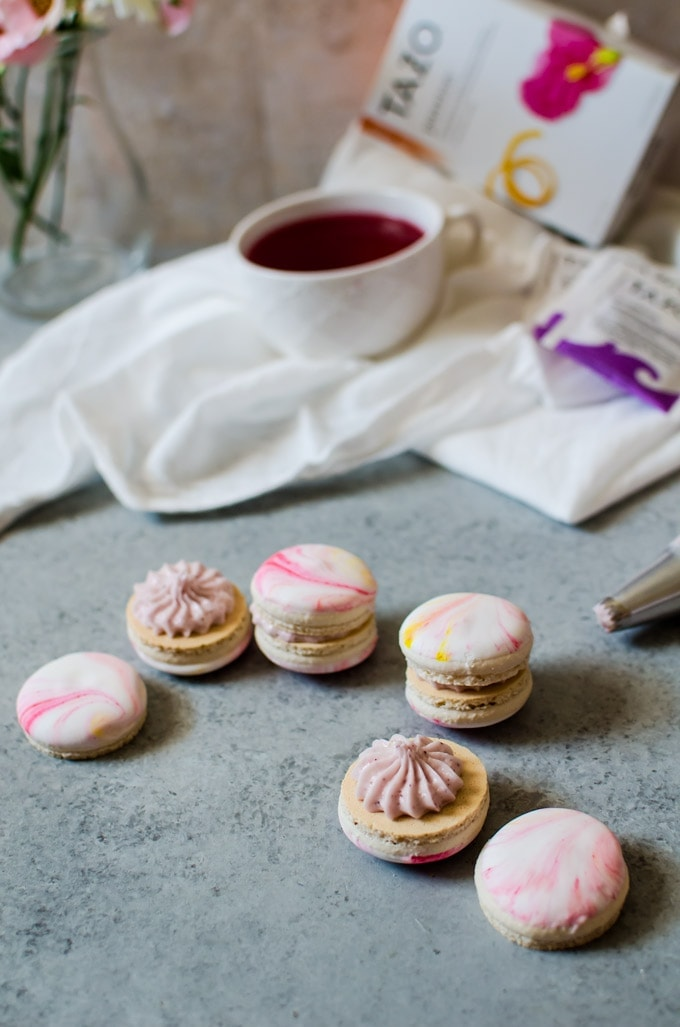 Vanilla bean macarons with a flavorful passion tea buttercream