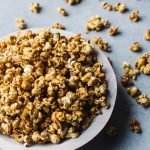 Your new favorite fall and winter snack: hot toddy caramel popcorn. Perfect with a hot mug of hot toddy!