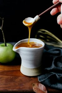 A sweet fall-inspired apple cider caramel sauce that you will want to use on everything!