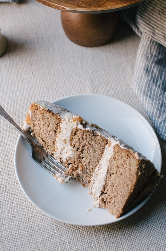 A deliciously moist apple spice cake with cinnamon frosting and apple cider caramel drizzle