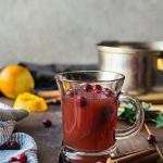 A deliciously warm and cozy mulled apple cider with cranberry