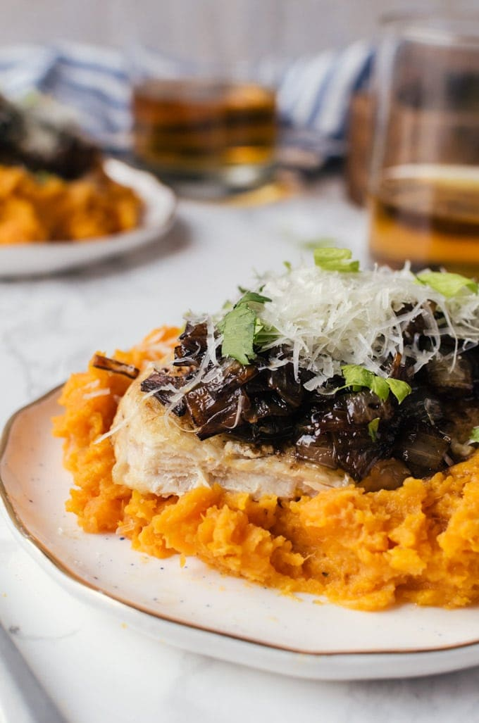 seared chicken with mashed sweet potatoes and caramelized onion