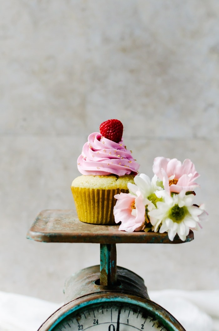 Champagne cupcakes with passionfruit curd and raspberry champagne swiss meringue buttercream