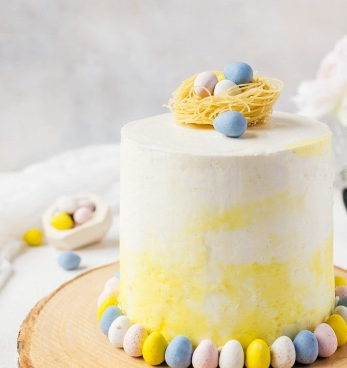 A tasty malt cake with white chocolate swiss meringue buttercream topped with cute chocolate Easter eggs