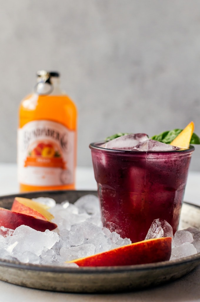 Welcome to your new summer drink. This blueberry basil peach fizz is probably the most refreshing cocktail you will try full of the best flavors of summer