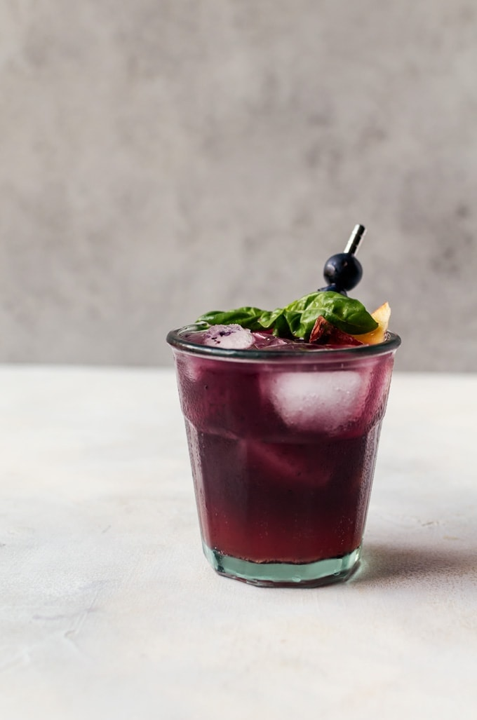A refreshing and irresistible blueberry peach fizz