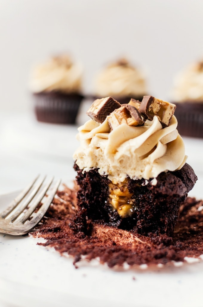 Nothing beats rich snickers cupcakes with a tall glass of milk