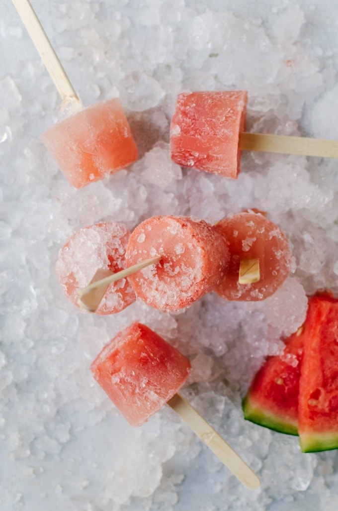 Refreshing watermelon mojito popsicles that will cool you down in just the right way this summer. Perfect for a summer girls' night in or barbecue!