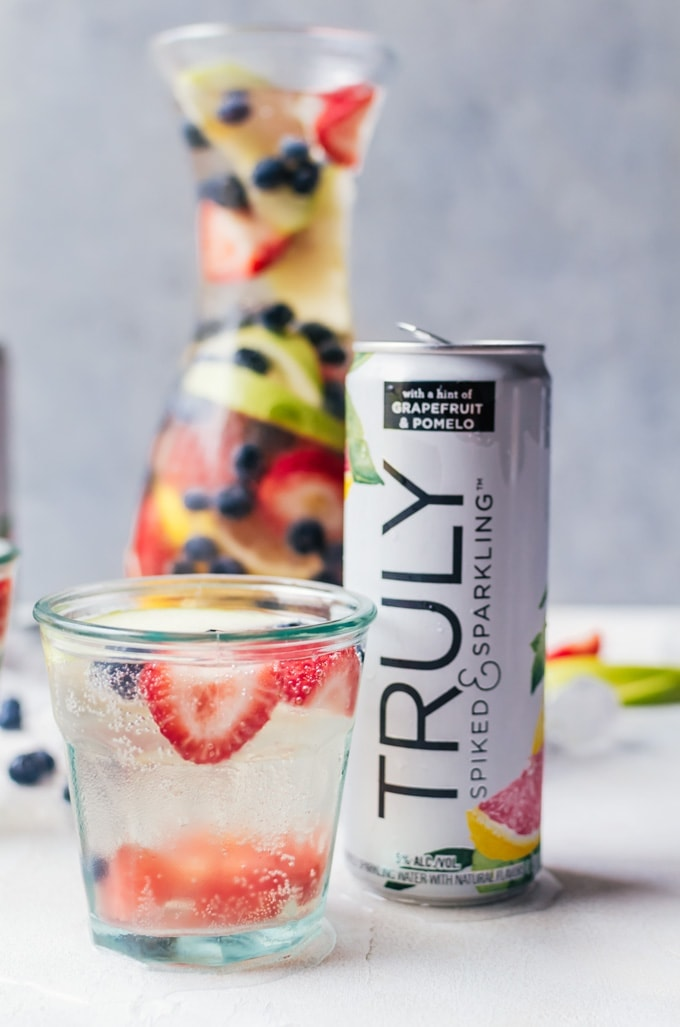A unique white wine sangria made with spiked sparkling water from Truly Spiked