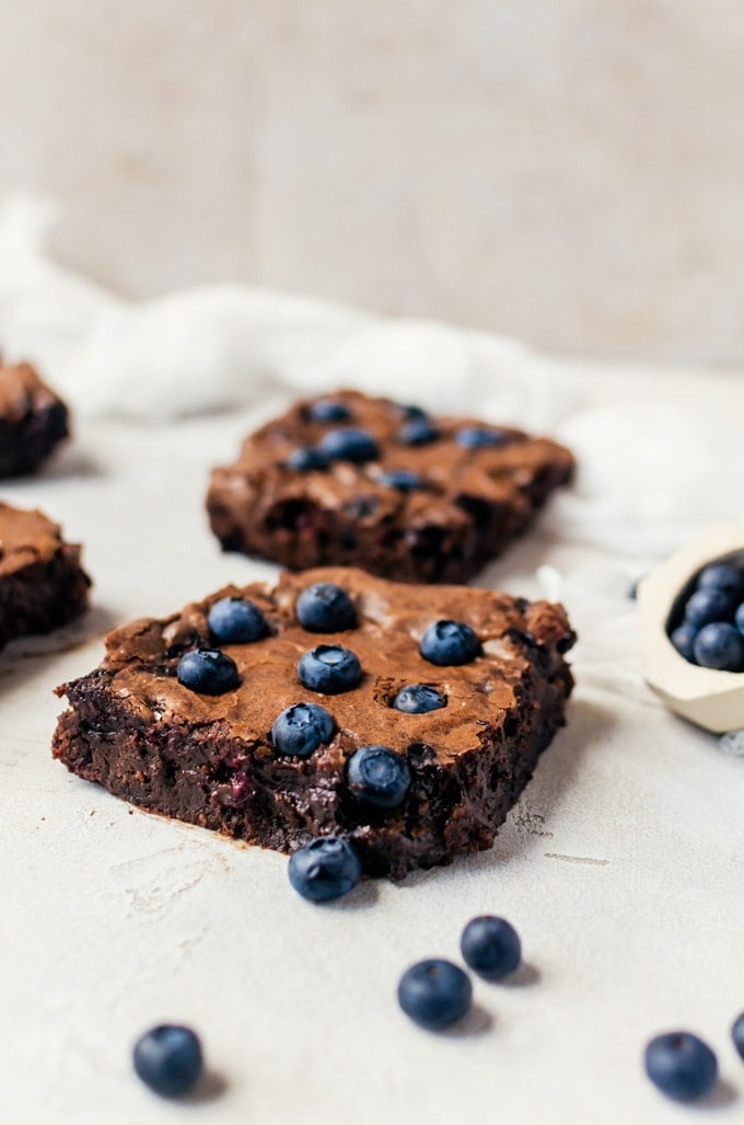 Fudgy blueberry brownies make the most irresistible dessert, especially topped with a big scoop of ice cream!