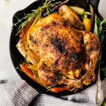 A juicy and savory garlic roasted chicken that will easily become a part of your weekly dinner rotation