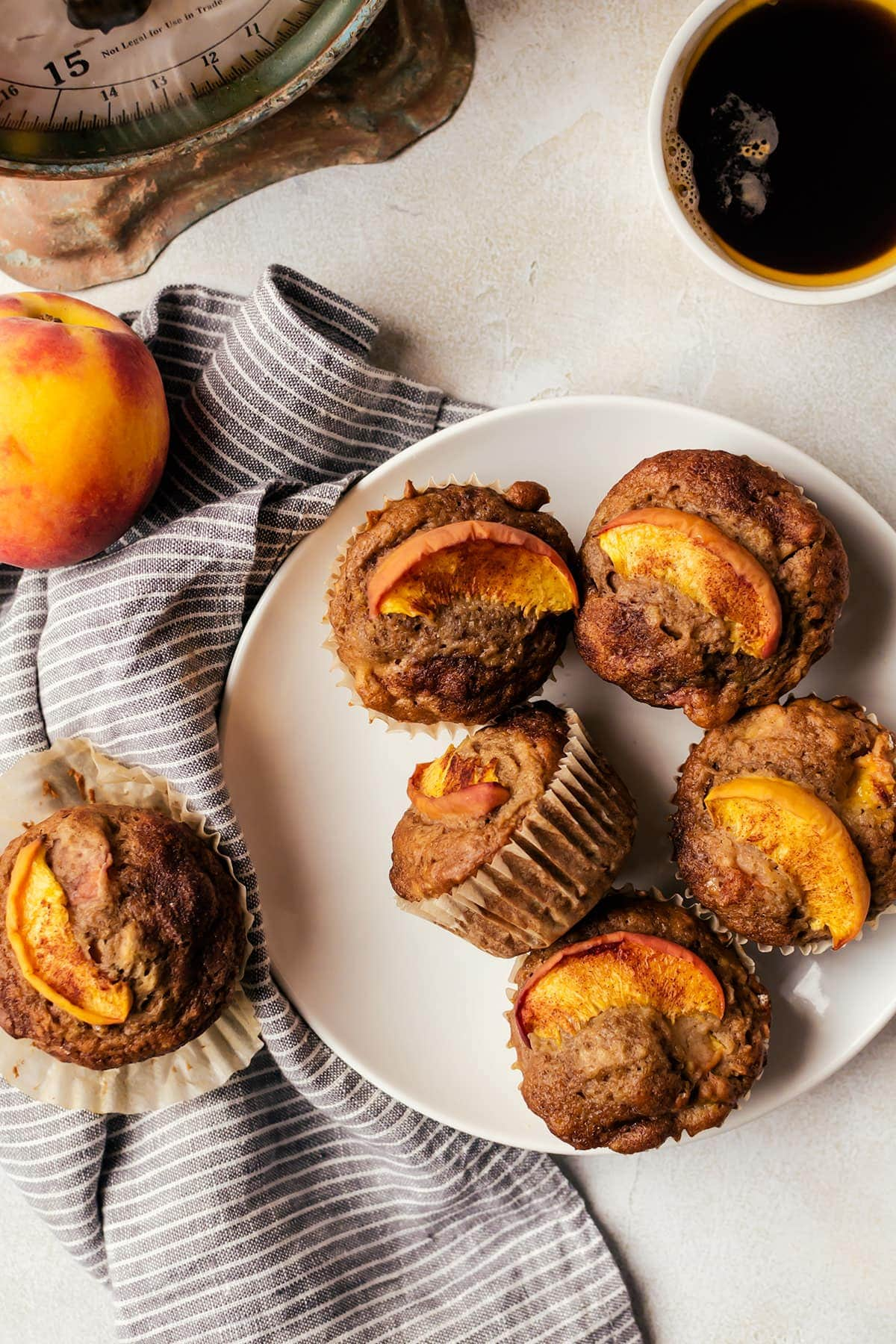 These fluffy cinnamon peach muffins are like a peach cobbler you can have for breakfast