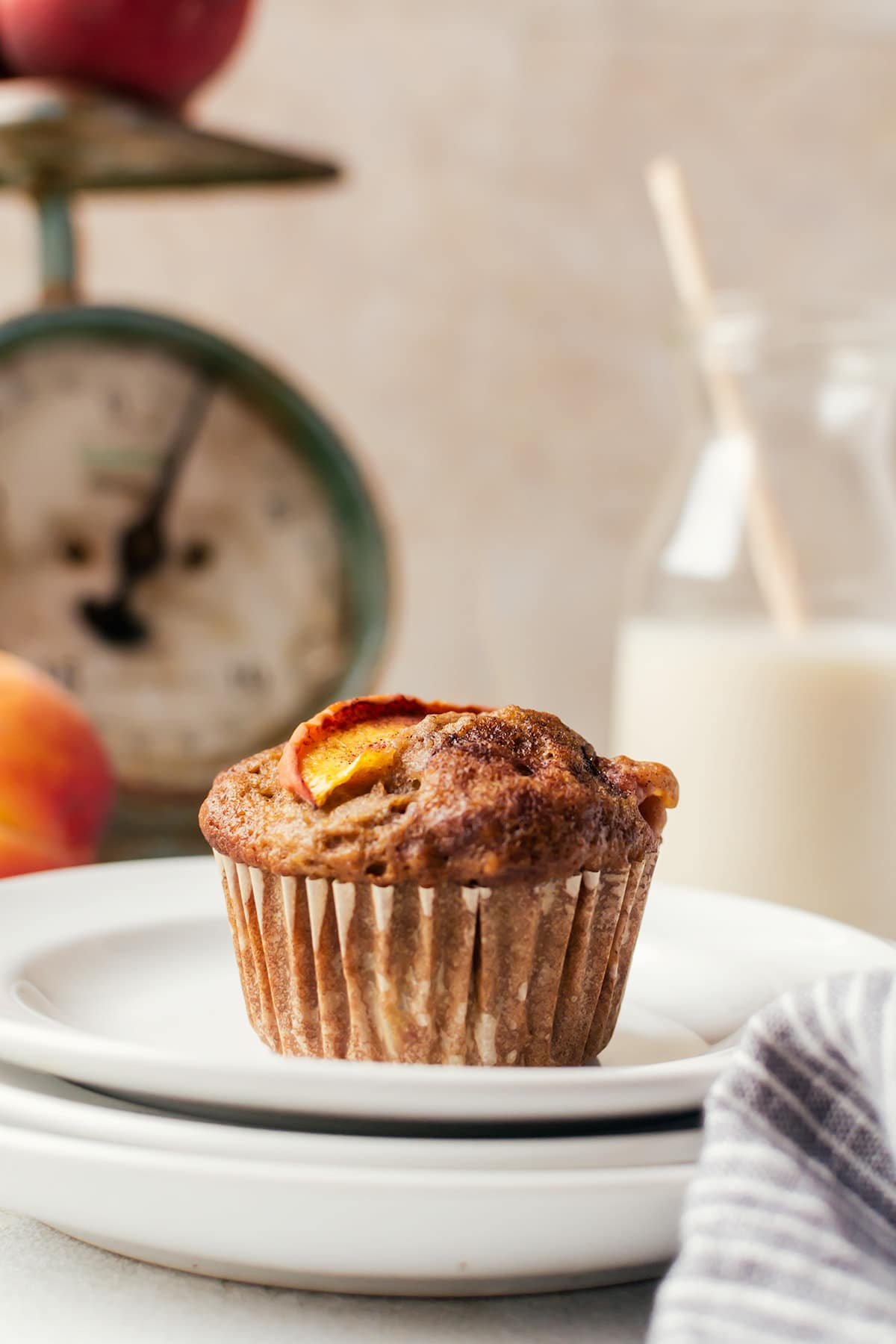 Tender and moist cinnamon peach muffins that will make every summer morning the best