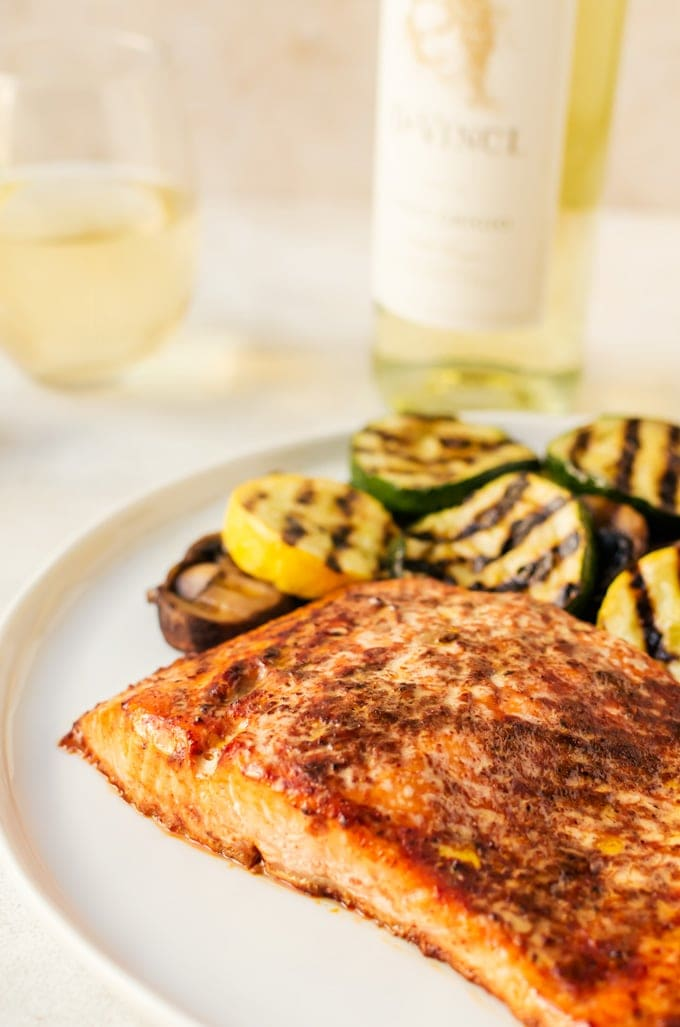 There is nothing better for dinner than a tender, flaky grilled barbecue salmon with grilled veggies