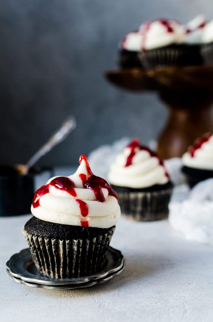"Halloween couldn't get spookier than with these black velvet cupcakes with drizzles of raspberry jam ""blood"""