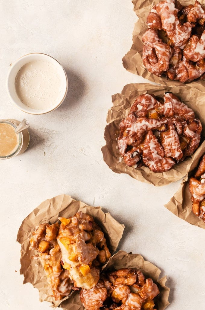 Irresistible peach fritters with maple glaze. There is nothing better than waking up to one of these in the morning