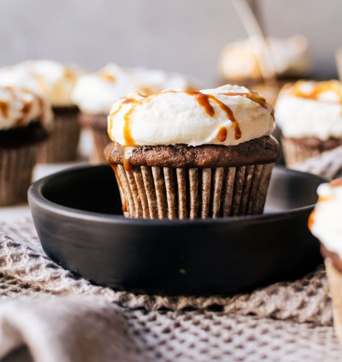 The perfect balance of coffee and pumpkin spice meet in an irresistible cupcake topped with airy whipped cream and finished with caramel