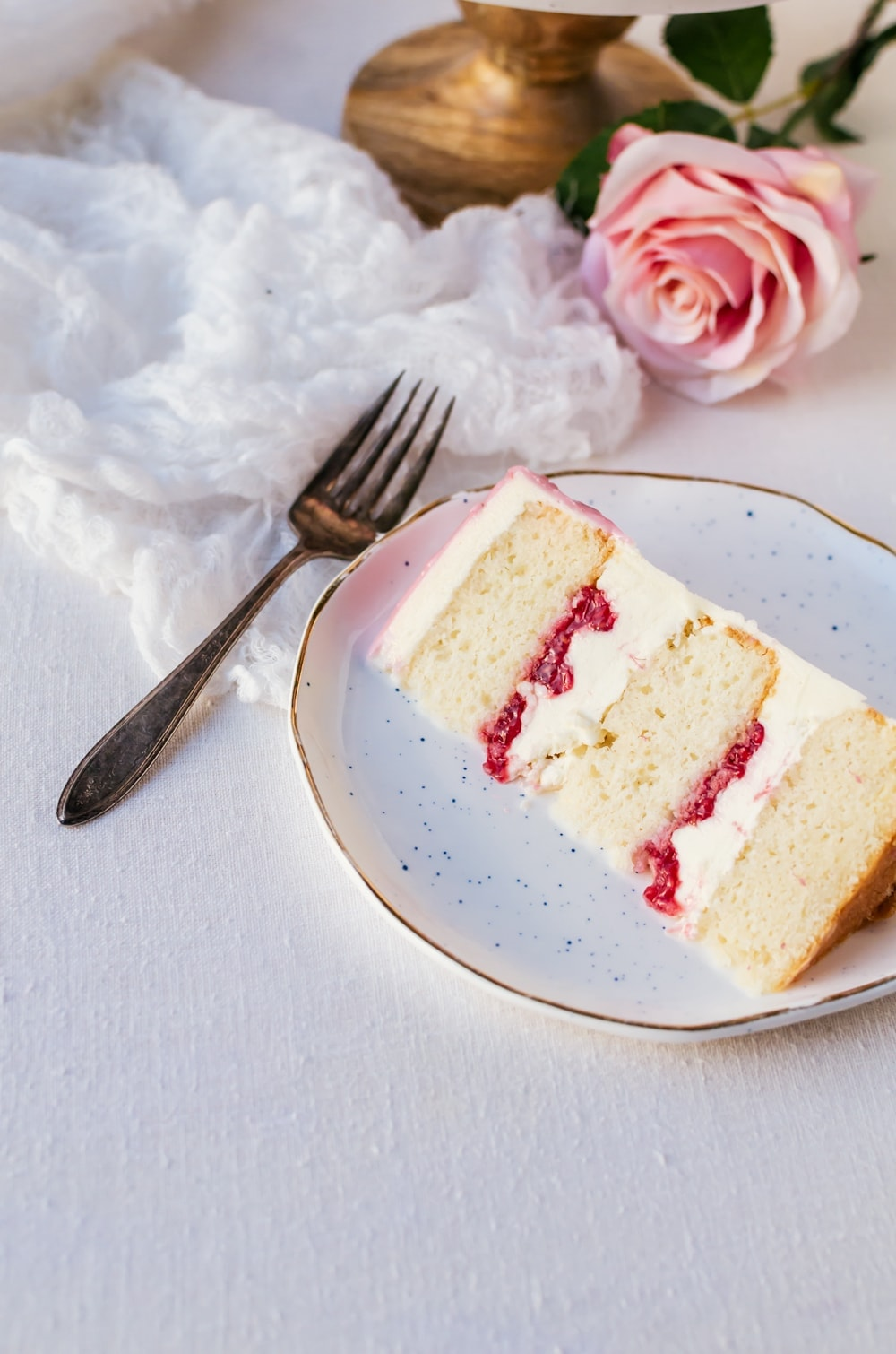 Enjoy the holidays with a raspberry rose cake made with sparkling rose wine