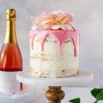 Showstopping raspberry rose cake made with sparkling rose win