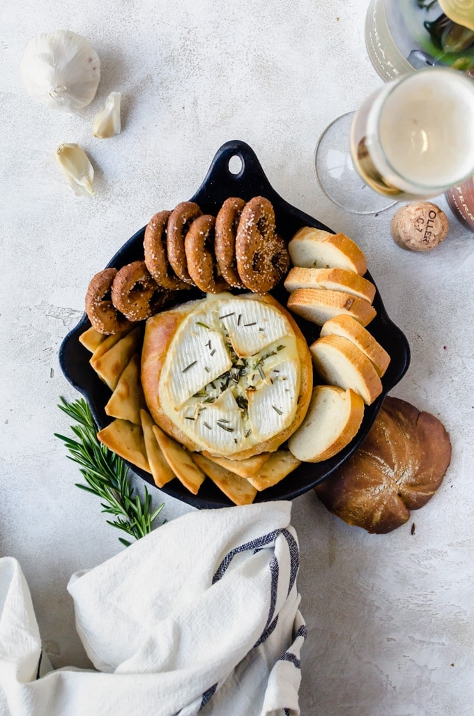 Warm, gooey rosemary garlic baked brie inside a crusty loaf of bread. It doesn't get any better than this