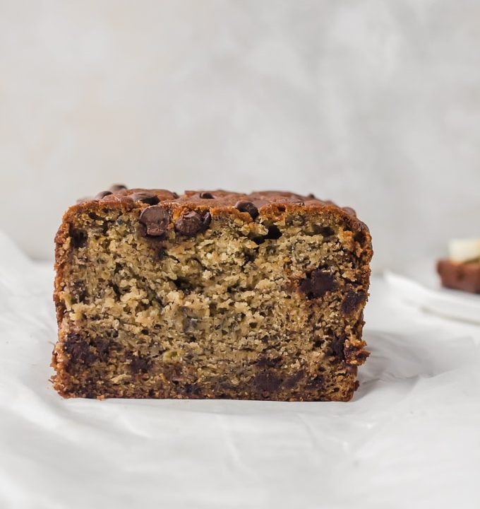 Straight on photo of brown butter banana bread loaf cut open