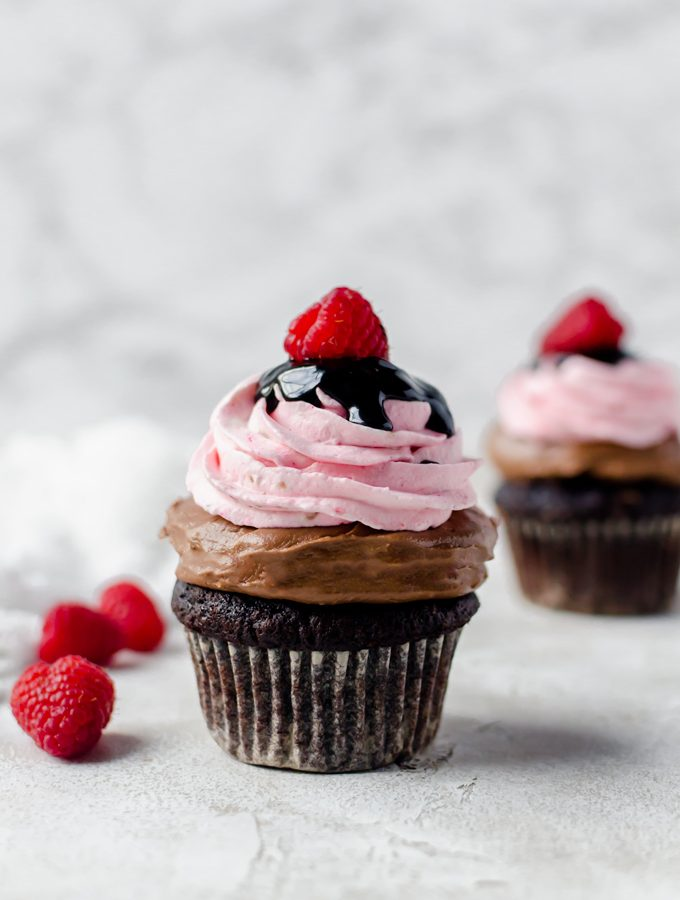 hero shot nutella chocolate cupcakes with raspberry whipped cream