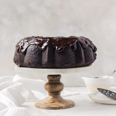 Chocolate stout bundt cake on a cake stand