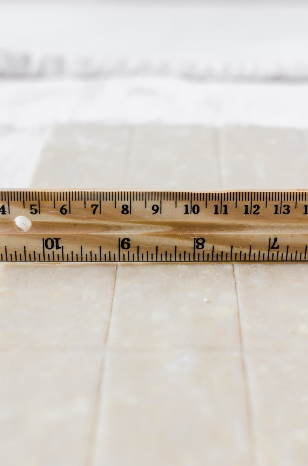 showing how you score the dough with your ruler