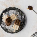 overhead shot caramel macchiato popicles on ice