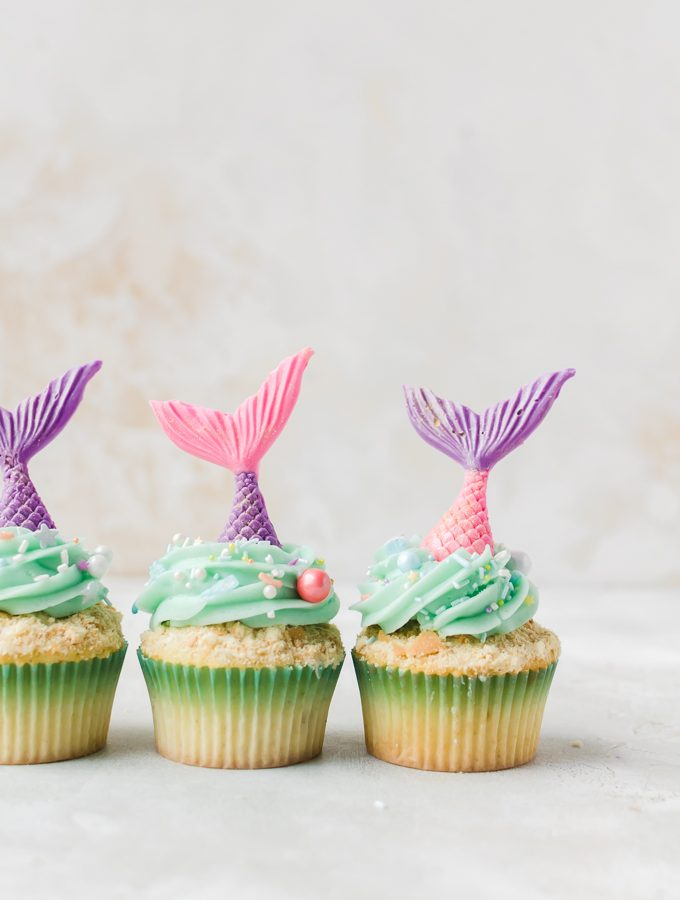 three mermaid cupcakes in a row