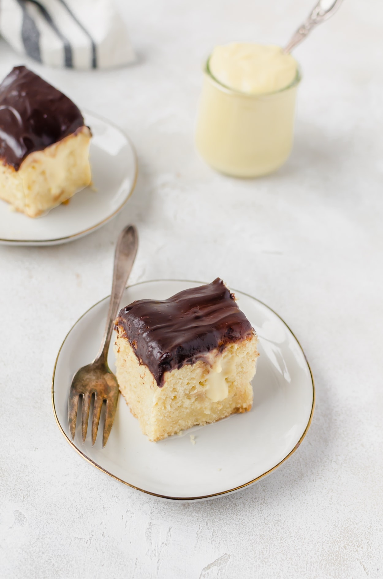 Relax with some milk and this boston cream pie poke cake