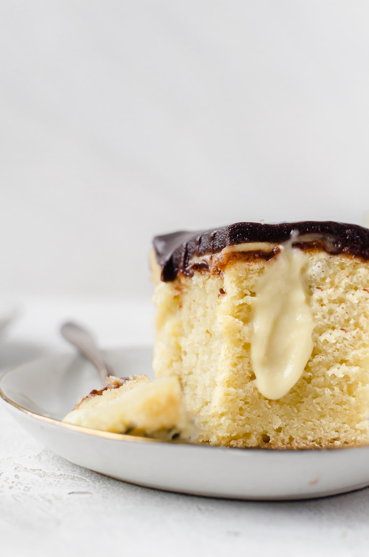 There isn't anything better than a cold glass of milk and boston cream pie poke cake