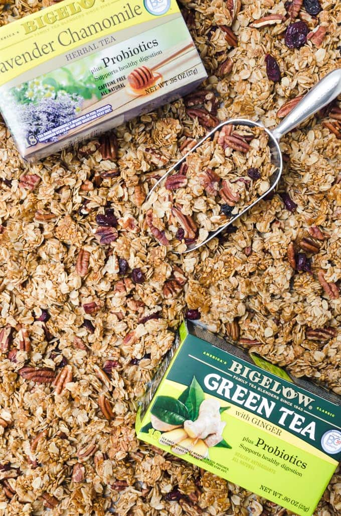 maple pecan granola in a baking sheet with tea
