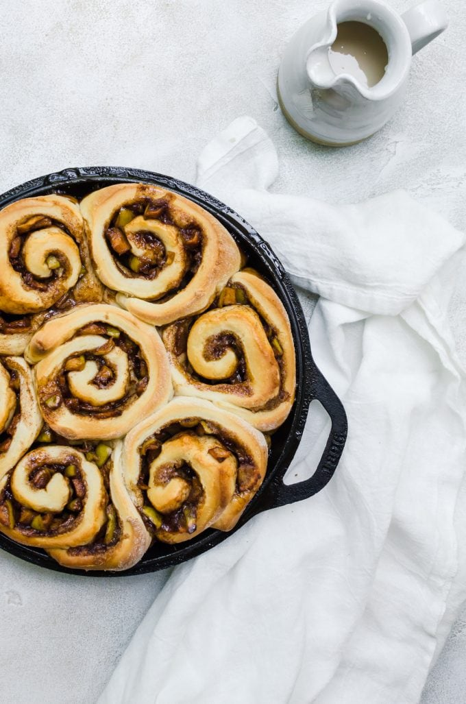 These are the fluffiest apple cinnamon rolls you will ever taste. They are stuffed with caramel apple pie filling and the best fall recipe ever #fall #fallbaking