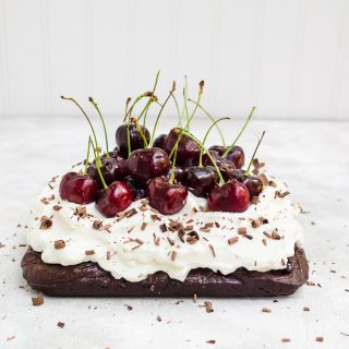 Black forest brownies topped with fresh cherries