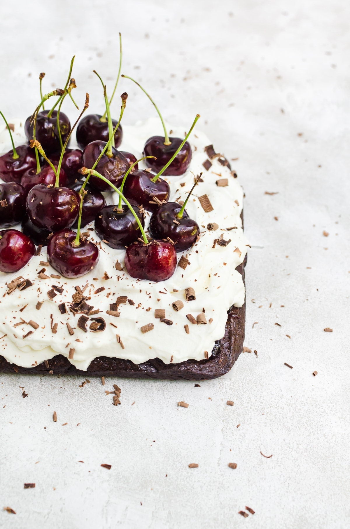 three quarters shot black forest brownies with shaved chocolate