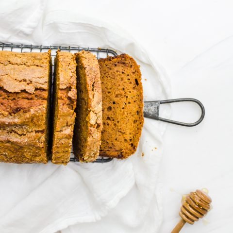 honey pumpkin bread on rack with slices cut