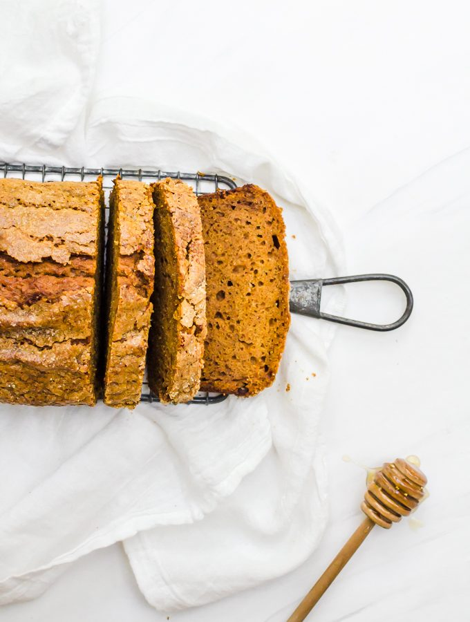 honey pumpkin bread on rack with slices cut