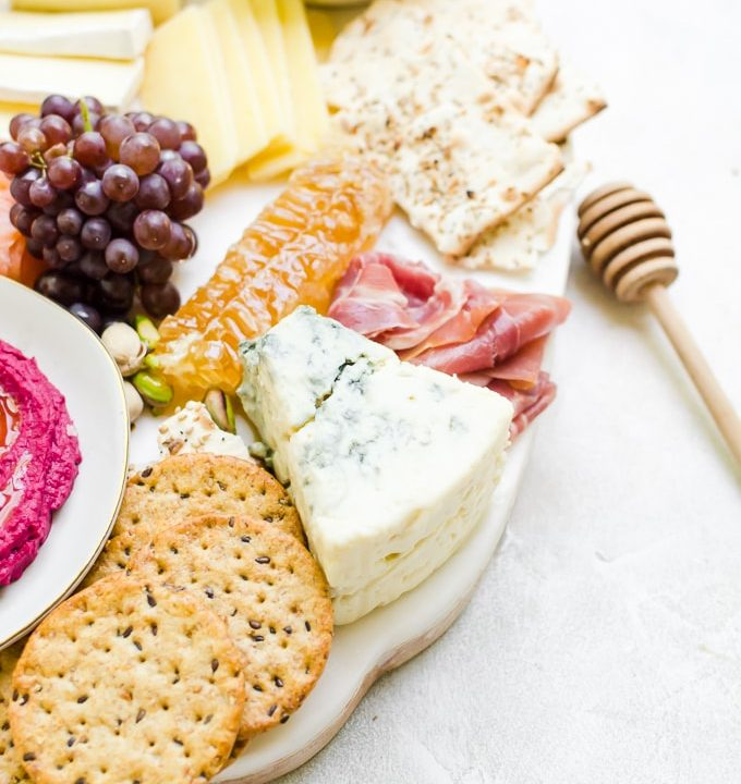 an incredible wanderlust cheese board inspired by cultures around the world