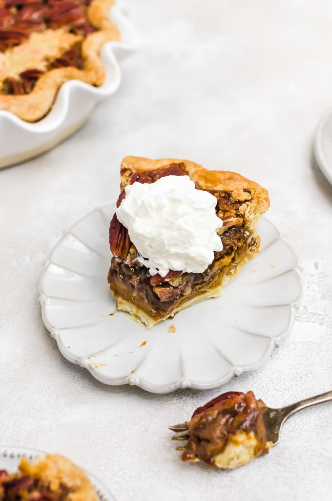 slice of chocolate pumpkin pecan pie with whipped cream