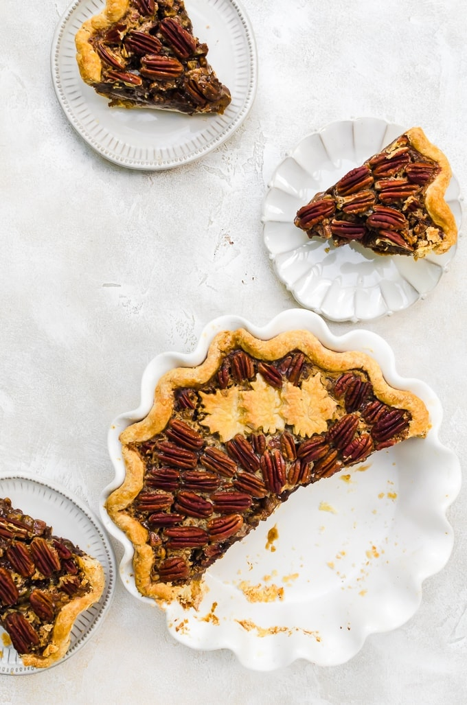 chocolate pumpkin pecan pie being served on plates